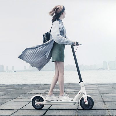 Lady riding Xiaomi MiJia Electric Folding Scooter